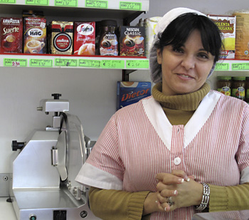 ENZA - Born in Sicily, raised back-and-forth between there and Australia. She and her husband own the corner grocery where I buy my water, and we chat.